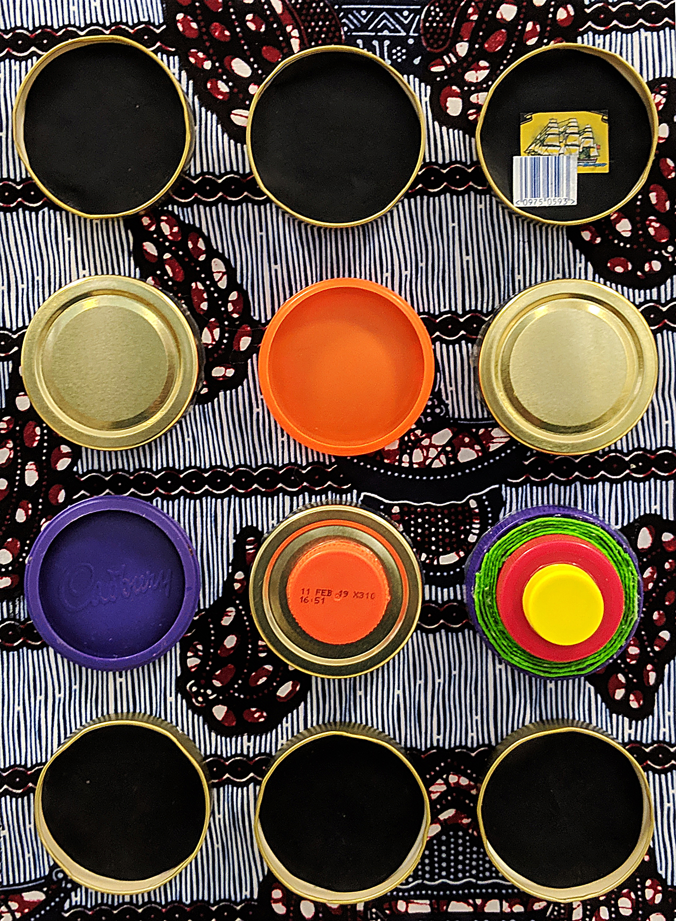 Sell by - Jam jar lids, bottle tops and fabric on canvas